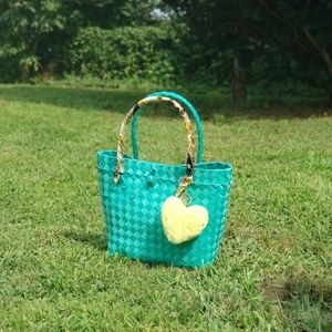 Handwoven handbag with charm and twilly
